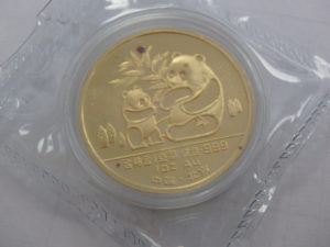 Chinese Gold Panda Coin Red Dot Discoloration Defect